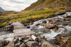 Norwegian mountain autumn landscape with bridge near Geiranger Stock Photos