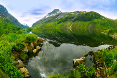 Norwegian mountain lake. Wide angle view of a picturesque lake in Norwegian mountains stock photos