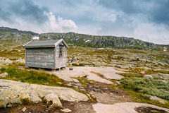 Norwegian mountains landscape. Old wooden house. Travel and hiki Stock Photography
