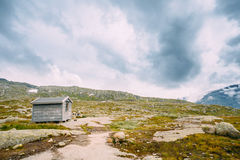 Norwegian mountains landscape. Small old wooden house Royalty Free Stock Image