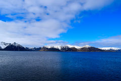 Norwegian mountains seen from the sea. Above the Arctic Circle. Royalty Free Stock Image