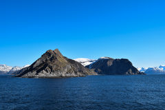 Norwegian mountains seen from the sea. Above the Arctic Circle. Royalty Free Stock Photography