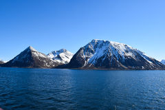 Norwegian mountains seen from the sea. Above the Arctic Circle. Stock Photo