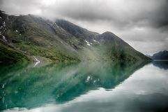 Lake reflections landscape in europe. Norwegian nature landscape at summer tourism trip Stock Images