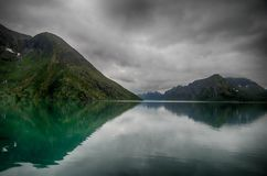 Lake reflections landscape in europe. Norwegian nature landscape at summer tourism trip Royalty Free Stock Images