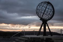 Norwegian north cape monument, without tourists making pictures, norway, europe, sunset stock photo