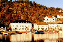 Norwegian old port over high cliffs Royalty Free Stock Images