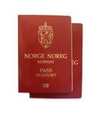 Norwegian passports. Two Norwegian passports isolated on white background stock photo