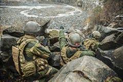 Norwegian patrol among the rocks Royalty Free Stock Photo