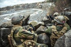 Norwegian patrol among the rocks Royalty Free Stock Photography