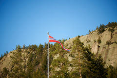 Norwegian pennant on a pole with mountains background horizontal Stock Photography