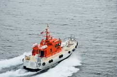 Norwegian Pilot boat leaving cruise ship after dropping off pilot Royalty Free Stock Photos