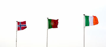 Norwegian, Portuguese and Italian flags stock photography