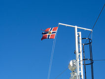 Norwegian Post flag in clear blue sky Royalty Free Stock Images