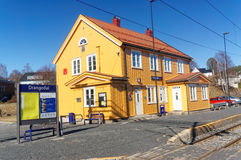 Norwegian railway station. Drangedal, Norway, March 21, 2015: Traditional Norwegian wooden building railway station in small city Drangedal. Early spring royalty free stock image