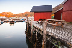 Norwegian red wooden barns on coast Stock Image