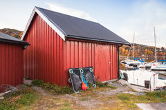 Norwegian red wooden barns. Traditional Norwegian red wooden barns stand on the sea coast. Snillfjord, Vingvagen fishing village Royalty Free Stock Photography