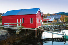 Norwegian red wooden fishing barn. Stands on the sea coast. Snillfjord, Sor-Trondelag region, Vingvagen village Stock Photos