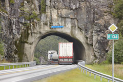 Norwegian rocky mountain road tunnel with heavy trucks Stock Photography
