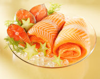 Norwegian salmon on a plate. Norwegian salmon on a glass plate stock photos