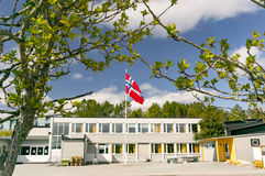 Norwegian school, in the middle of the mast flag of Norway Royalty Free Stock Photo