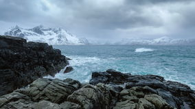 Norwegian Sea waves on rocky coast of Lofoten islands, Norway. Waves of Norwegian sea crushing on rocky coast in fjord. Vikten, Lofoten islands, Norway stock footage
