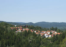 Norwegian suburb. Suburb at Baerums Verk outside Oslo, the capital of Norway, in a typical Norwegian sloping landscape, with pine forest and wooden houses Stock Image