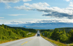 Norwegian summer road (near Dombas, Norge) Royalty Free Stock Photo