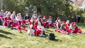 Norwegian teenagers in russ costumes rest Stock Photography
