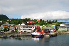 Norwegian town with small wharf by the fjord Royalty Free Stock Image