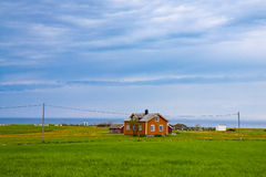 Norwegian traditional alone house in countryside Royalty Free Stock Image