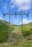 Norwegian Transmission Tower 001. Transmission tower leading up a rocky hill in the Rogaland mountains, Norway stock photo