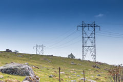 Norwegian Transmission Tower. Transmission tower leading up a rocky hill in the Rogaland mountains, Norway royalty free stock photo
