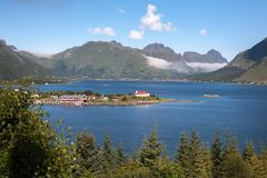 Norwegian view. With blue fjord, mountain and houses Royalty Free Stock Image
