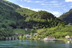 Norwegian Village. A photograph of the village of Flåm in Norway. Flåm is a village at the inner end of the the fjord of Aurlandsfjorden, an arm of Royalty Free Stock Photos