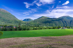 Norwegian village under the mountains Stock Photography