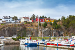 Norwegian village, wooden houses and fishing boats Royalty Free Stock Photography