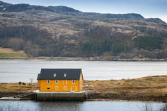 Norwegian village with yellow house on coast Royalty Free Stock Photography
