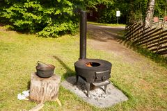 Norwegian vintage stove. With fire in Folk museum in Oslo stock photos