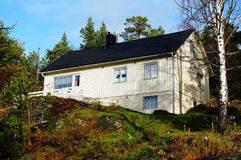 Norwegian white wooden residential house Stock Photography