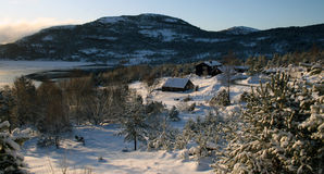 Norwegian Winter. A tine mountain farm in rural Norway in winter royalty free stock image