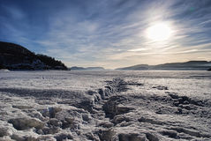 Norwegian winter. The fjord close to Hygen,Buskerud,Norway is cover by ice during the winter Stock Photo