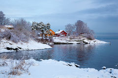Norwegian winter fjord landscape with colorful houses Stock Photo