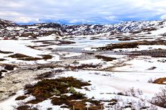 The norwegian winter landscape: mountain and river Royalty Free Stock Photography