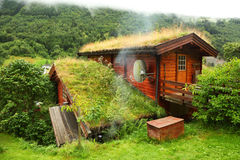 Norwegian wooden house on hill Stock Image