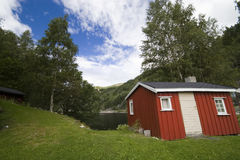 Norwegian wooden hut, lakeside Stock Photo