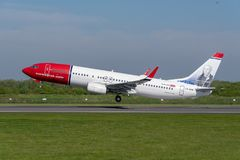 Norweigan Airlines Boeing 737 departing Manchester airport. MANCHESTER, UNITED KINGDOM - MAY 07, 2018: Norweigan Airlines Boeing 737 departing Manchester airport stock images