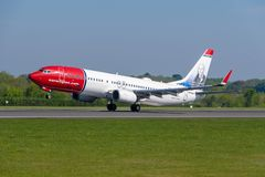 Norweigan Airlines Boeing 737 departing Manchester airport. MANCHESTER, UNITED KINGDOM - MAY 07, 2018: Norweigan Airlines Boeing 737 departing Manchester airport stock photos