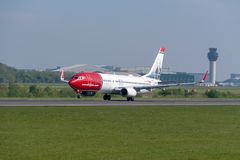 Norweigan Airlines Boeing 737 departing Manchester airport. MANCHESTER, UNITED KINGDOM - MAY 07, 2018: Norweigan Airlines Boeing 737 departing Manchester airport stock image