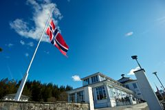 Norweigian flag at half mast. Norweigian flag flying at half mast atop the Floibanen Funicular Royalty Free Stock Images